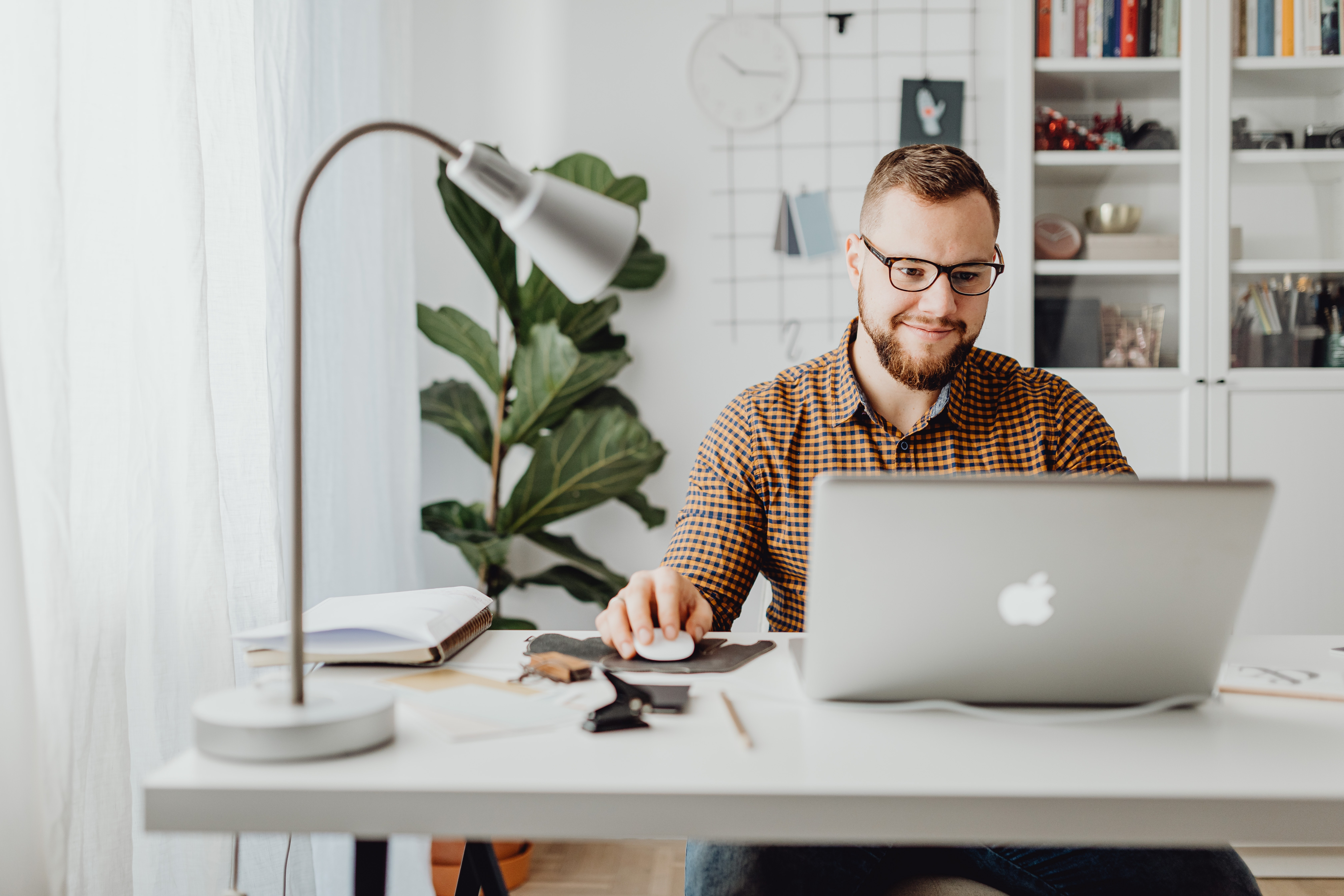 Adult man remote working on computer